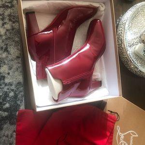 Christian Louboutin Boots.Brand New. Run small. 40